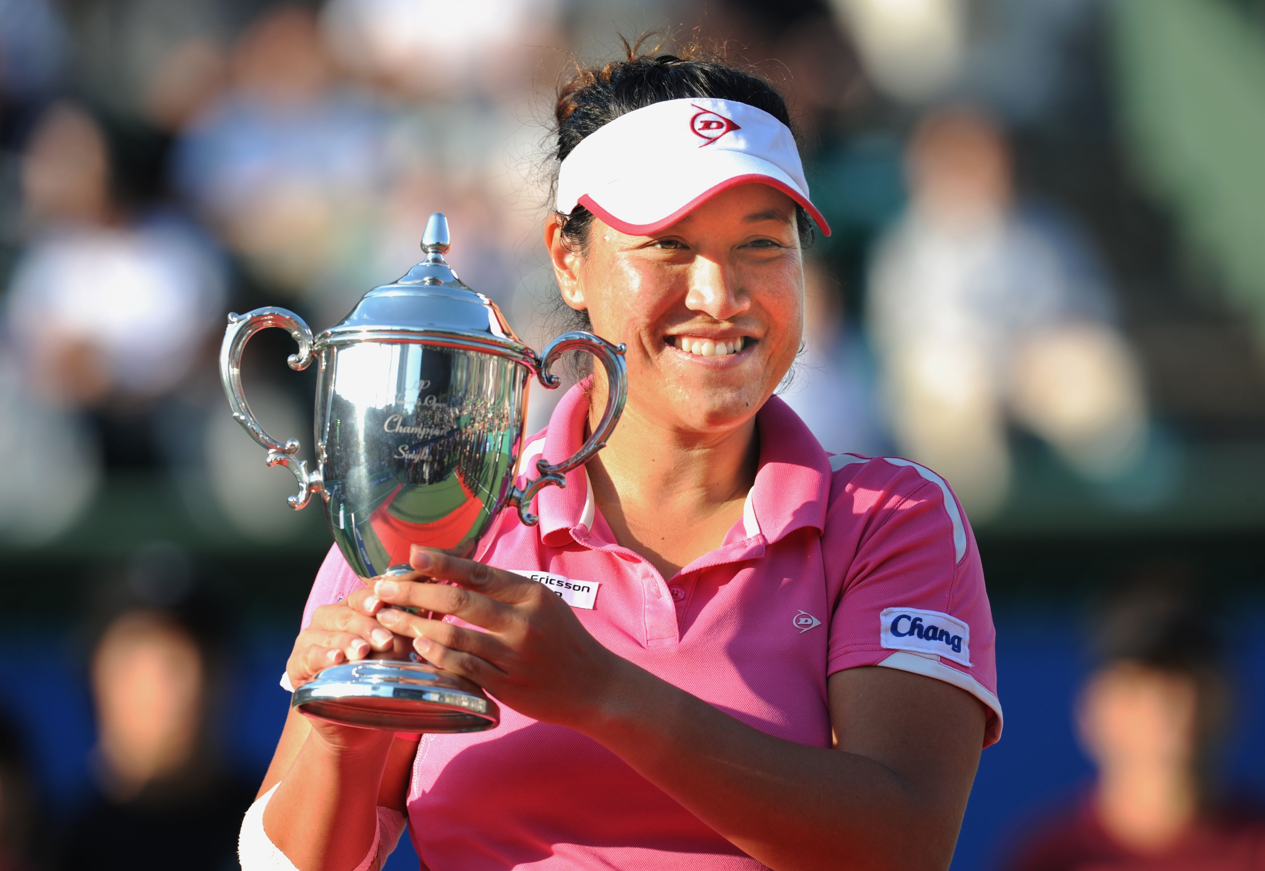 Tamarine Tanasugarn of Thailand holds the champions trophy during an awards ceremony following her women's singles final match against Kimiko Date Krumm of Japan at the Japan Women's Open tennis tournament in Osaka on October 17, 2010. Tanasugarn won the match 7-5, 6-7, 6-1. AFP PHOTO/Kazuhiro NOGI / AFP / KAZUHIRO NOGI