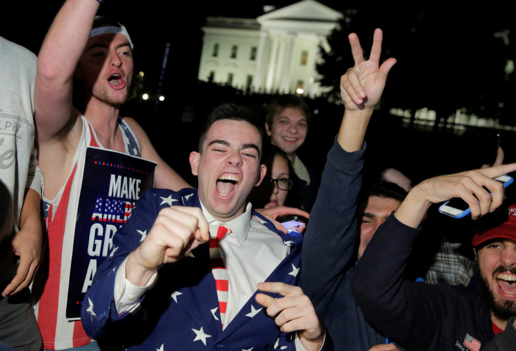 Supporters of Republican presidential candidate Donald Trump rally in front of the White House in Washington, U.S. November 9, 2016. REUTERS/Joshua Roberts
