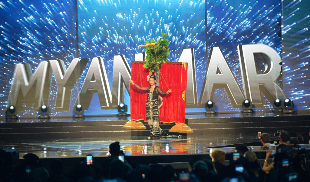 Miss Universe contestant Htet Htet Htun of Myanmar performs a puppetry during the national costume and preliminary competition of the Miss Universe pageant at the Mall of Asia arena in Manila on January 26, 2017. / AFP PHOTO / TED ALJIBE