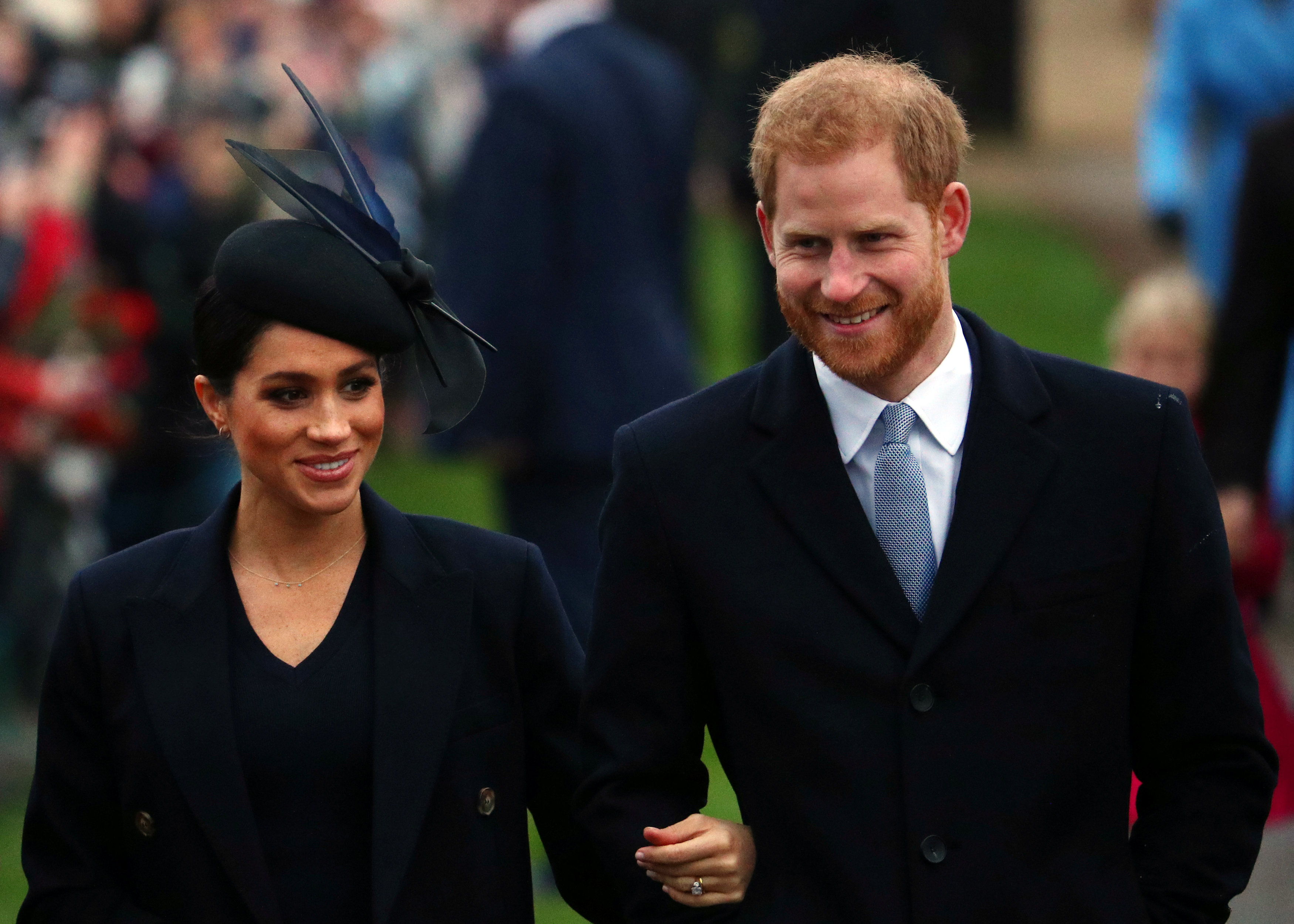 Britain's Prince Harry, Duke of Sussex and Meghan, Duchess of Sussex arrive at St Mary Magdalene's church for the Royal Family's Christmas Day service on the Sandringham estate in eastern England