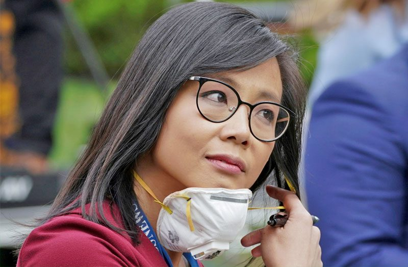 """CBS News White House correspondent Weijia Jiang after asking U.S. President Donald Trump why he was saying """"Don't ask me, ask China that question"""" to her during a briefing at the White House in Washington, U.S., May 11, 2020. REUTERS"""
